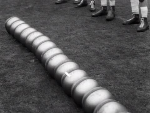 Players collect their helmets at the start of an American football match at Wembley Stadium