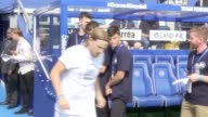 Players from Team Shearer and Team Ferdinand run onto the pitch at Loftus Road where celebrities firefighters and survivors are playing a charity...
