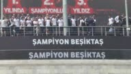 Players of Besiktas arrive at Dolmabahce district with a boat accompanied by their supporters' boats for the soccer match between Besiktas and...