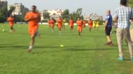 Players of West Bankbased football team Ahli AlKhalil Club take part in the team's training session ahead of their Palestine Cup first leg match...