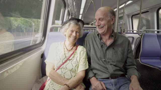 Playful Senior Couple on Subway Train