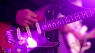 Playing An Electric Guitar at concert party