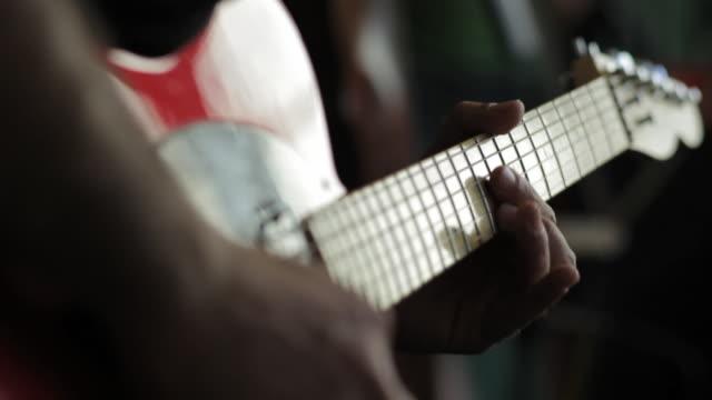 C/U Playing electric guitar