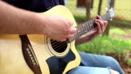 Playing Guitar Outside