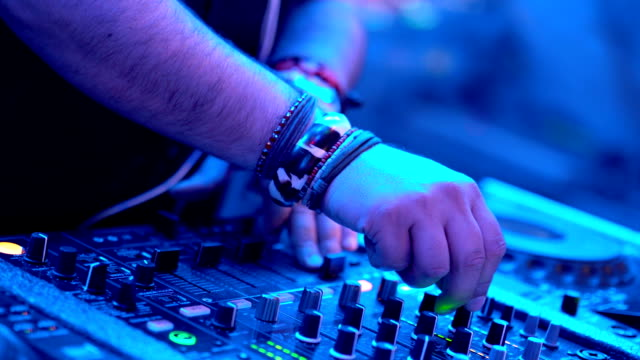 DJ playing music at a party.