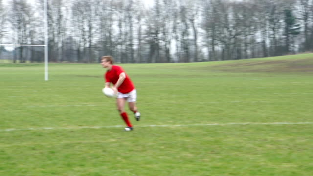 Playing Rugby in a match on a grass field