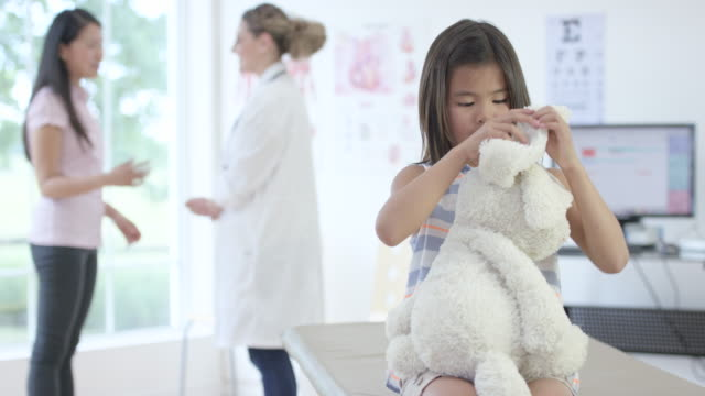 Playing with a Toy Rabbit at a Doctor's Appointment