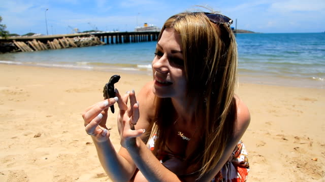 Playing With Baby Sea Turtle
