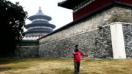 Plays Chinese YoYo before temple of heaven in Beijing