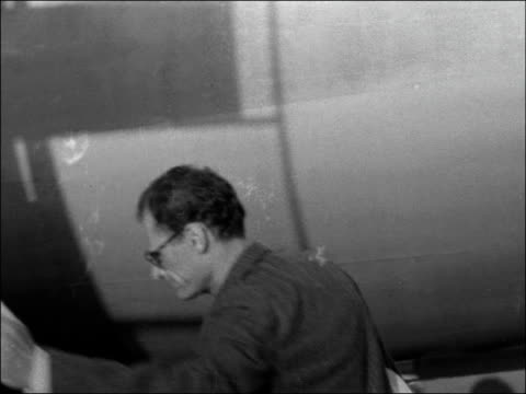 Playwright Arthur Miller leaves London ENGLAND London Airport EXT Arthur Miller along tarmac and boarding plane / TX 26856 / 1045pm