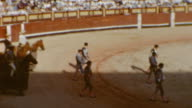 Plaza De Toros Entrance / Bullfighters enter ring / Bull chases Matador / Sevilla Scenic / Archival Bullfighting Ring on July 01 1955 in Madrid Spain