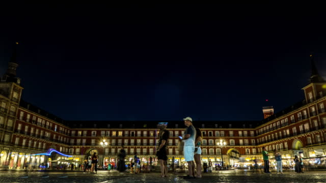 plaza mayor madrid timelapse at night with peddiers of lights