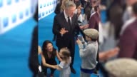 Please credit @JoPrestonTV/Twitter Alec Baldwin at the Boss Baby premier teaches a young boy how to perfect a Donald Trump impression