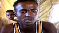 Plight of Somali refugees INT Refugees gathered in tent Abdul Fatah Weheliye interview SOT Talks of an attack by the islamic militia on the cinema he...