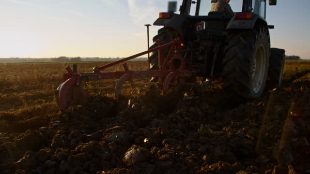 SLO MO Plowing the field with a tractor