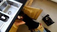 Plumber / Handyman working under Kitchen sink - CRANE HD