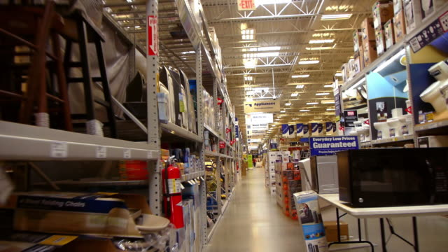 WS POV Plumbing and appliances section in big box hardware store / Palm Desert, California, USA