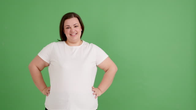 plump girl smiling on the green screen