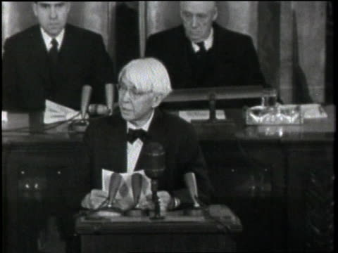Poet Carl Sandburg reads a tribute to Abraham Lincoln in the senate chambers