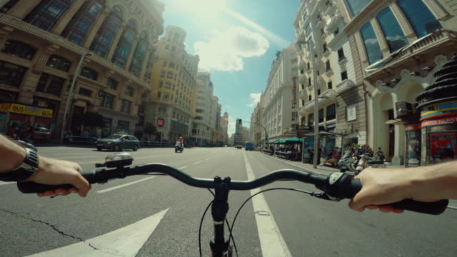 Point of view POV bicycle ride in Gran Via of Madrid