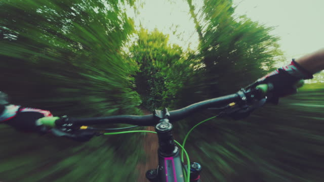 Point of view POV mountainbike fast ride in the forest