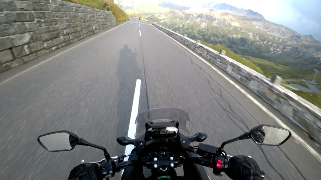 Point of view of a motorcycle on mountain road in Austria