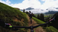 Point of view pedalling on mountainbike with girl