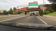 Point of view shot driving along highway towards Washington DC Traffic in Washington DC on June 01 2013 in Washington DC