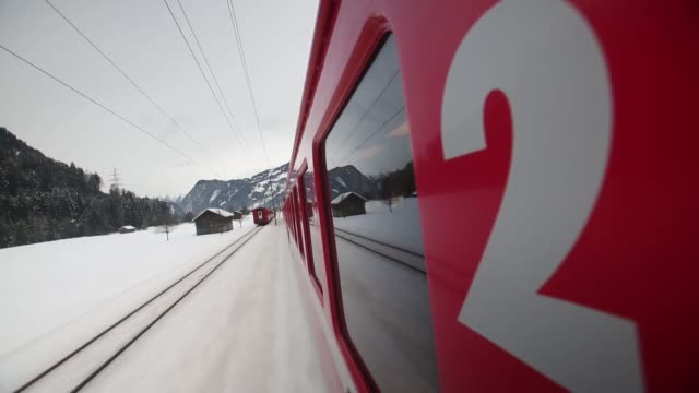 Point of view shots from moving RhB train as travel through snowcovered countryside in Swiss Alps to Davos ahead of the 2013 World Economic Forum...