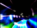 CGI point of view through curving tube lined by colored streaks of light on black background