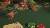 Poker chips falling on to card table, Spain