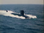Polaris ballistic missile being launched from submerged submarine tilt up with ascending trajectory / United State Navy nuclearpowered attack...