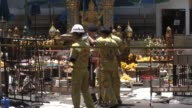 Police and Emergency responders investigate the scene of a bombing at the Erawan shrine a popular tourist attraction at the Ratchaprasong...