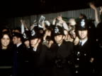 Police attempt to control fans of The Osmonds outside concert venue carrying teenage girls to ambulances 1973
