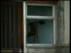 Police call for end to vigilante attacks after paedophile suicide House with broken window in Plymouth ENGLAND Devon Plymouth Crome Walk EXT Crowds...