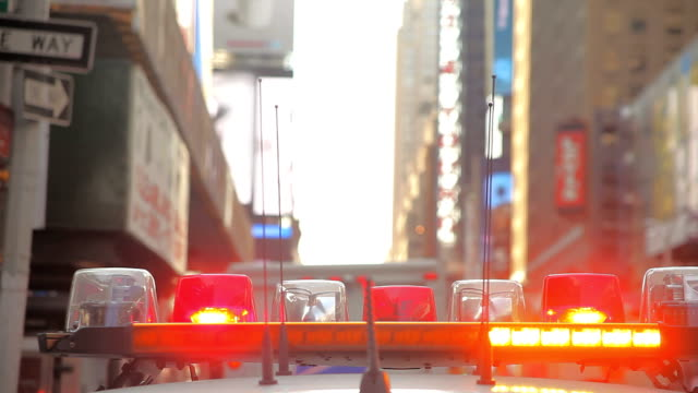 NYPD Police Car on Times Square in New York City With Emergency Lights Beam Car On
