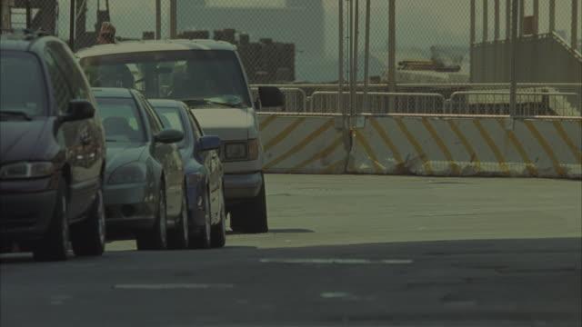 Police cars speeding around a corner during daytime.