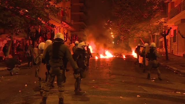 Police clash with demonstrators in Athens following a rally commemorating the 1973 Athens Polytechnic student uprising against the US backed military...