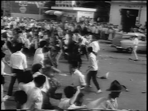B/W 1963 police clashing with protesters at Buddhist protest / South Vietnam / newsreel