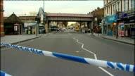 Police cordon off road in West London following reports of gunfire ENGLAND London Shepherd's Bush EXT Cordonedoff road