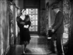 B/W 1931 police detective (Eddie Kane) accosting Irene Dunne in hallway / feature