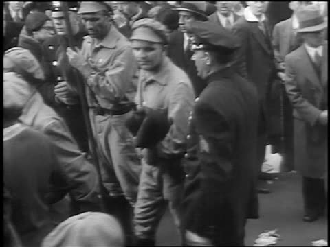 B/W 1933 police escorting 2 men with Russian caps at Communist demonstraton / Union Square NYC