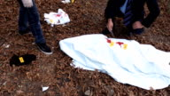 Police examining a dead body