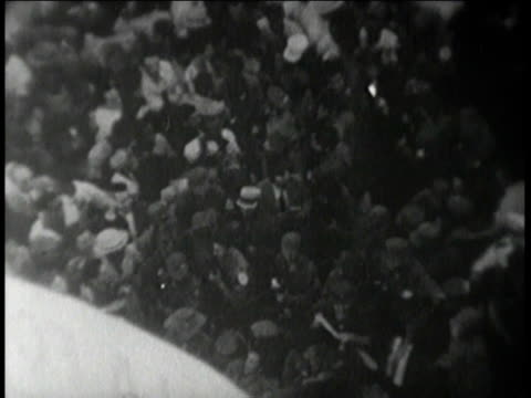 police fighting with crowds / Fidel Castro walking through mob / crowds cheering