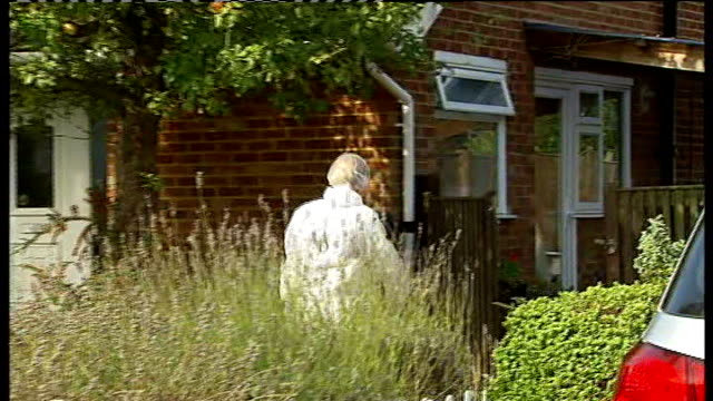 Police find body of missing pensioner in garden of house ENGLAND Surrey Godalming EXT Police forensics officer along to garden of house in white...