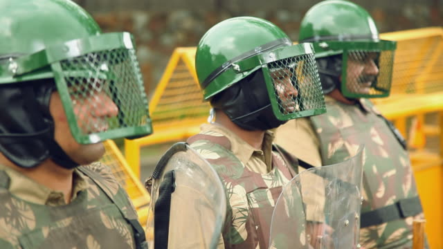 Police force controling riots, Delhi, India