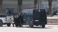 Police forces take security measures around the National Bardo Museum where at least 21 people including 17 foreign tourists were killed in an attack...