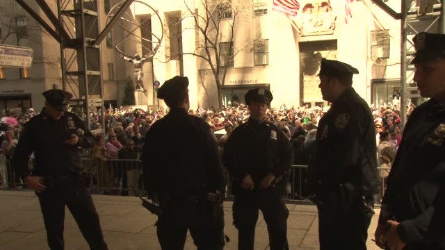 NYPD police gather on steps of St Patrick's Cathedral NYC's Annual Easter Bonnet Parade at 5th Avenue on April 08 2012 in New York New York