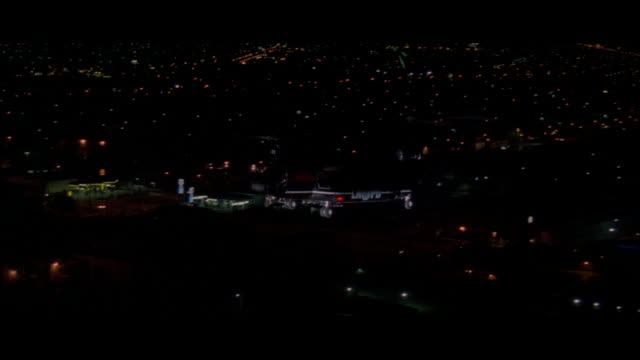 WS TS Police helicopter flying over city at night  / Unspecified