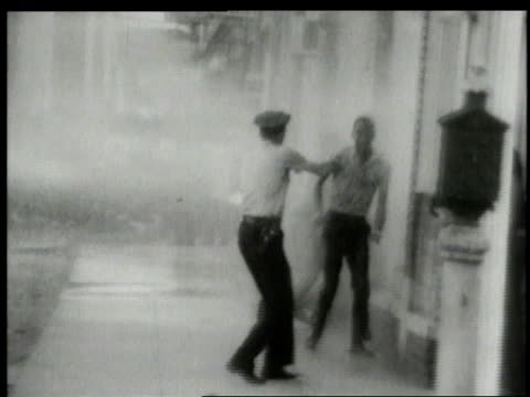 Police hosing rioting civil rights demonstrators in streets / Alabama United States